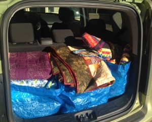 Bags, quilts, and teaching supplies packed.  John is on his way to another event to share his quilting knowledge.